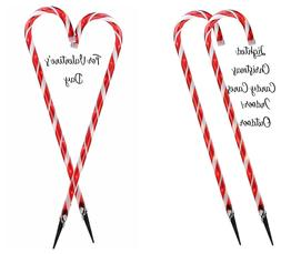 2 candy cane lights in outdoor decorations