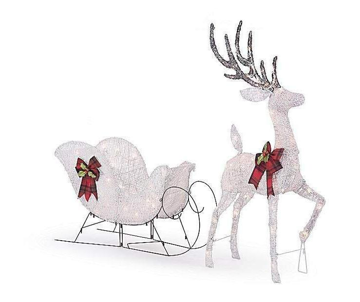 lighted white reindeer and sleigh sculpture outdoor